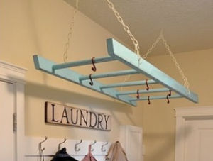 hanging ladder in laundry room as a drying rack