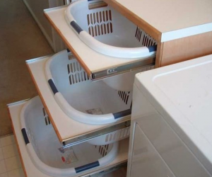 sliding baskets in laundry room