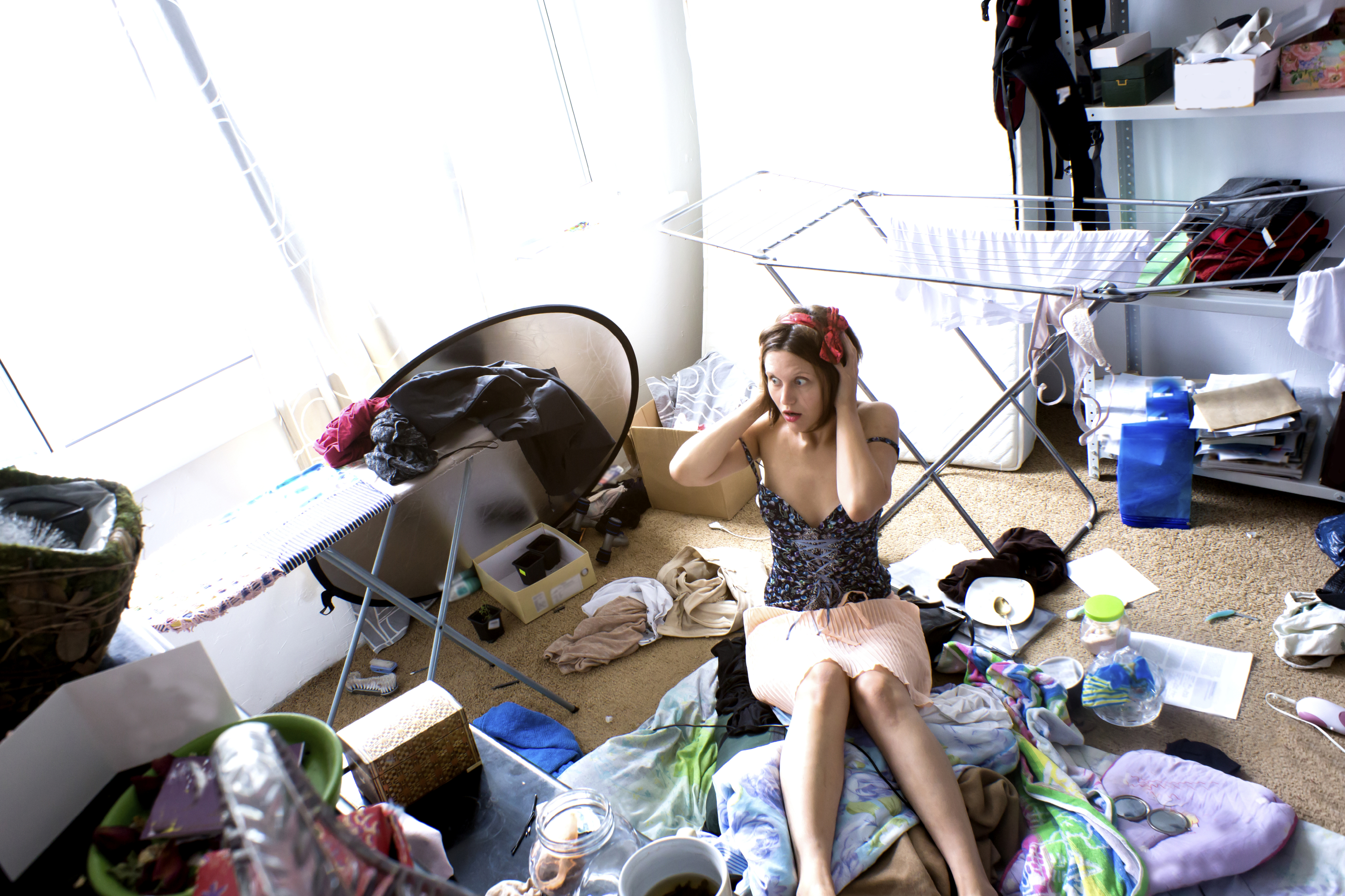 woman stressed out by messy house