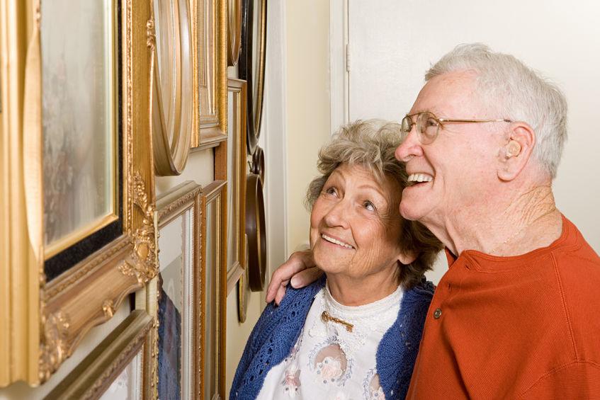 Senior couple looking at photographs